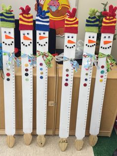 Quick, cheap and easy Christmas present from student to make for parents! Snowman snow gauges! Made out of picket fence posts, glove, Google eyes, pompoms, buttons and a glue gun.