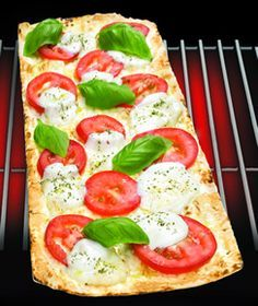 We made some of these pizza last night on Flat Out bread, totally saved the carbs, and took away the guilt!  I found they work better cooked for 10 min versus 4 what all the recipes call for.  Let them sit to cool a min before slicing them up, then enjoy!