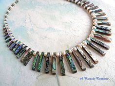 Gorgeous graduated Abalone Shell (also known as Paua Shell) Fan necklace is adorned with Fresh Water Button Pearls, Hematite Rondelles, and Shell Jewelry, Shell Earrings, Shell Necklaces, Beach Jewelry, Jewelry Necklaces, Latest Jewellery Trends, Jewelry Trends, Jewelry Ideas, Diy Jewelry