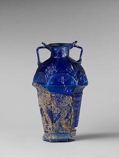 Glass hexagonal amphoriskos Signed by Ennion   Period:     Early Imperial, Julio-Claudian Date:     1st half of 1st century A.D. Culture:     Roman Medium:     Glass; mold-blown
