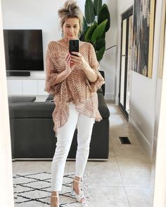 Sheer tunic, skinny jeans and ankle strap sandals | Photo by Suzie Richetti | For more style inspiration visit 40plusstyle.com