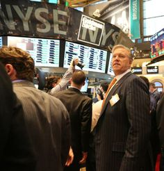 Elway & Ellis Ring the NY Stock Exchange Opening Bell.