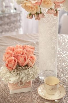 cute little table decorations! Love the lace on the vases! Would look awesome on a coral table cloth!: