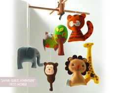 This safari animals nursery mobile from Gifts Define is the perfect handmade decor to go in the nursery! #PNpartner