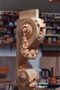 Close up detail of carving showing swags, shells - swags shells console table hampton court