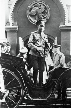 Emperor Nicholas II exits his carriage in front of the Boyar Romanov house on Varvarka Street in Moscow. The family's coat-of-arms can be seen above the entrance. 1913