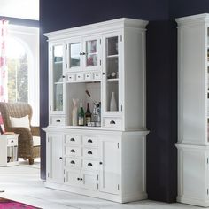 The perfect storage solution for your kitchen or dining room. Functionality is the key. Glass inserts in Shaker Style doors offer a glimpse at some of your favorite collectibles. The variation in drawer dimensions brilliantly accommodates any of your needs, small or large.The central recess, highlighted with attractive beadboard wainscotting, can function as a coffee or wine bar,or simply display some of your favorite cookbooks