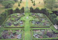 The Garden at Highgrove - The new planting scheme is entirely black and white. In this, its first summer, the garden was full of black-leafed 'Bishop of Llandaff' dahlias (disbudded of their red flowers), black grasses, black-stemmed dogwood, black violas, white poppies and aquilegia. In the spring it will begin with snowdrops followed by black and white tulips.