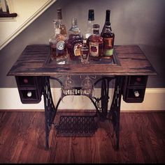 Refurbish a sewing table into a wine and bar cart.