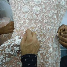Last appliqués on a couture silk thread embroidered and beaded wedding dress | #inthemaking #dressmaking |#handembroidery #couture #beading #artisanal #bridal #fashion #bespoke #ethicallymade #bridetobe #bordado #ricami #novia #bride #wedding #weddingdress