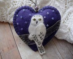 Snowy Owl poses majestically on a fallen log so you can see how handsome he is! I made this gorgeous ornament from 100% wool felt in a soft violet