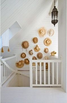 cottage décor can be as simple as your straw hat collection on a wall