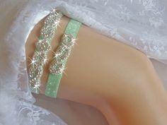 A personal favorite from my Etsy shop https://www.etsy.com/listing/254162346/mint-wedding-garter-set-green-glitter