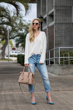 5133593_meagan_brandon_fashion_blogger_wearing_transitional_spring_look_with_sweater__boyfriend_jeans_and_louboutin_blue_suede_pumps__nude_prada_bag