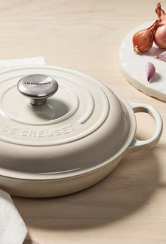 Le Creuset Braiser in Meringue -- Whether you're cooking for two or simply trying to save space in the kitchen, meet your new favorite pan. The enameled cast iron Braiser is the perfect size for small portions or small spaces.