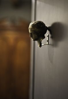 what a door knocker! a commenter thought it might be a DIY since they had the same bronze goddess head from the gift shop of a Greek museum.