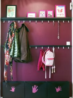 Hang a row of TJUSIG high and low so everyone in the family can reach to hang up their things.