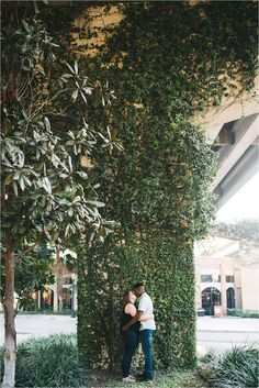 couple having an engagement session under the i4 overpass in downtown orlando