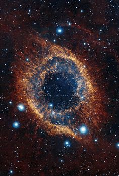 #HelixNebula | ESO's Visible and Infrared Survey Telescope for Astronomy (VISTA) has captured this unusual view of the Helix Nebula (NGC 7293), a planetary nebula located 700 light-years away. The coloured picture was created from images taken through Y, J and K infrared filters. While bringing to light a rich background of stars and galaxies, the telescope's infrared vision also reveals strands of cold nebular gas that are mostly obscured in visible images of the Helix.