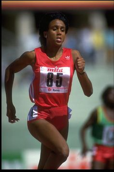 "Charmaine Crooks was a track athlete and was the flag bearer at the Opening Ceremony of the 1996 Olympic Games. She's a member of the Order of Canada and was awarded the 2006 ""Women and Sport Trophy"" in recognition of promoting gender equity in sport. She's inducted into the Athletics Canada Hall of Fame and BC Sports Hall of Fame. She was both the 1st Canadian woman to run 800 metres in under 2 minutes and to be recognized with the Jack Diamond Award as BC's 2009 Sports Personality of the… Order Of Canada, Sports Trophies, Gender Equity, I Am Canadian, Sports Personality, Sport Hall, Track And Field, Opening Ceremony, Olympic Games"