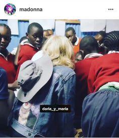 """American pop-singer Madonna wears the jacket by DARIA Y MARIA! 🎉 She posted photos of our jacket """"Frida"""" in her social networks! it's the SUCCESS for us!!!👍🏼POP-Королева Мадонна в июле была замечена в джинсовом жакете """"Фрида"""" от бренда DARIA Y MARIA во время своего благотворительного визита в Кению. В своих соцсетях и на официальном сайте Мадонна выложила видео в нашей джинсовой куртке👍🏼#мадонна #madonna #frida #madonnaafrica #fridajacket #курткапопарт #курткафрида #фриданакуртке…"""