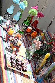 dessert bar--colorful bottled drinks with pompos