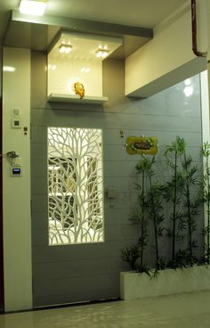 Glossy Finish Wooden Entrance 🚪 Door with abstract Tree Jali Design in the center, highlighted with Recessed Lighting ✨ - GharPedia House Main Door Design, Door And Window Design, Main Entrance Door Design, Home Entrance Decor, Door Design Interior, Wooden Door Design, Foyer Design, Front Door Design, Home Room Design