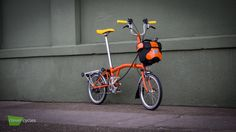 This juicy orange Brompton Bicycle with matching O-Bag, lemon grips & saddle is ripe and ready for action.