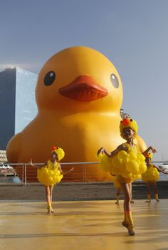 Dancers dressed up as ducks celebrate the giant rubber duck in Taiwan