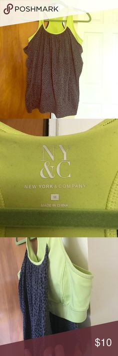 Leopard print workout top Neon green sports bra built in to this flowy tank with a fitted band at the bottom. This top does not run true to size. Definitely intended for a full bust. I wear a VS 32DD and it felt loose on me. New York & Company Tops Tank Tops