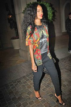 There's no such thing as being dressed down when you're style-statement-loving Rihanna. The singer chose a graphic print top and roomy black slacks for a night out on the town, tying the pieces together with a black banded sandal.