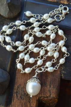 Lustrous white freshwater pearl wire wrapped necklace by Purrrls