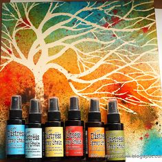 Using a tree stencil, spray ink colors over top - love this color combination.