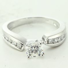 Channel Set Diamond Engagement Ring With Round Side Stones
