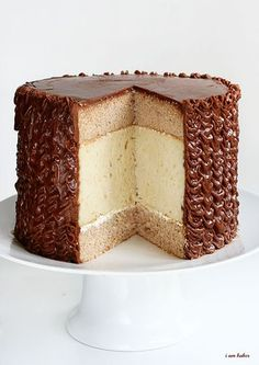 "The ""Ultimate Dessert Cake"" is a cinnamon cake surrounding a white chocolate cake covered in chocolate frosting."