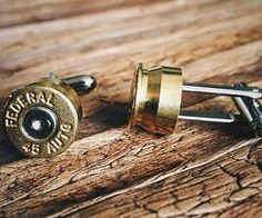 Give your formal wear a little second amendment flair by accenting it with these elegant bullet cufflinks. These custom cufflinks employ a real re-purposed bullet casing to make it appear as if you've got a bullet lodged through your shirt.