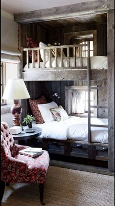 Reclaimed Wood Bunk Beds, Sisal Rug, White Linens, and Vintage Chair. Handsome and Masculine Rustic Cabin Bedroom.