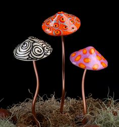 An artist who creates the ornamental garden mushrooms. Some have copper stems...others ceramics. Sold in sets at a mostly reasonable price. thebohemianmushroom.com