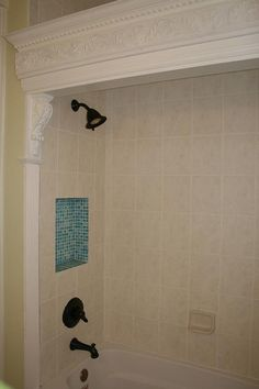 Reclaimed wood cornices and tile detail in our bathroom.