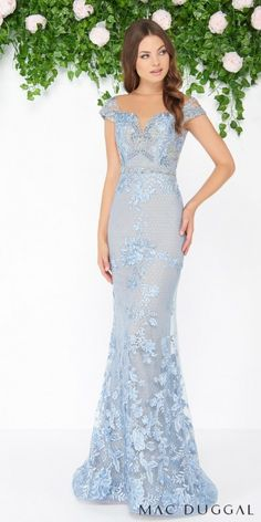 Leave an ever lasting impression as you make your grand entrance to the soiree in this Cascading Lace Applique Open Back Trumpet Evening Dress by Mac Duggal. This style includes an illusion neckline with dainty cap sleeves, a show stopping keyhole open back, and a beautiful trumpet silhouette that is adorned with beading and appliques. #edressme