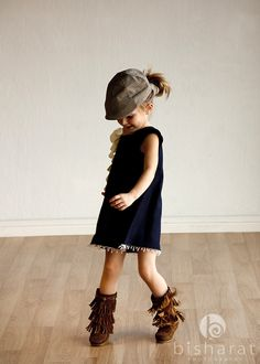 I now have the sudden urge to ensure my girls have suede fringed boots for the fall. Darling.