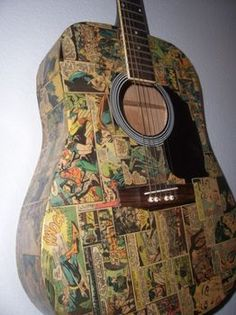 Decoupage Comic Strip Guitar. - THIS IS THE COOLEST IDEA! Will be doing this to something...
