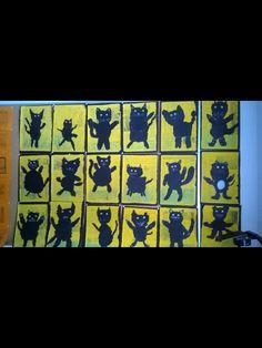 Anu Potkunen / Fb Alakoulun aarreaitta  Kolmasluokkalaisten taiteilemia pääsiäisnoidan kissoja. Sanomalehden sivu maalattiin keltaisella pullovärillä. Ruohoa liidulla. Kissan osat revittiin mustasta piirrustuspaperista.