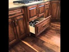 A gas #cooktop with #cabinet below fit for pots and pans #storage.  |  YouTube.com