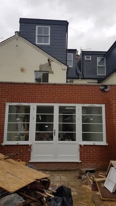 French doors with top hung side lights. Supplied by Timber Windows Direct.