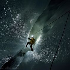 Insta / natgeo: Photo by @shonephoto (Robbie Shone) - An Italian explorer traverses through a canyon avoiding deep cold water below a thin unstable crust of ice inside a moulin on the Gorner glacier Switzerland. Progress is often slow when the floor is dangerously unstable like here. This was the first of many glacier caves we descended during our recent expedition to the area. More to follow...