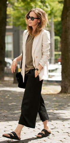 a beige blazer from Massimo Dutti, silk top, culotte shorts from Zara and sandals from Birkenstock