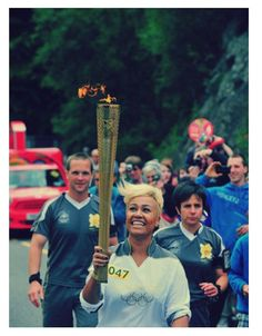 R singer Emeli Sande carries the Olympic Flame on the journey from Glencoe to North Ballachulish during Day 22 of the Olympic Torch Relay. Emeli Sande, Olympic Flame, Olympics, Singer, London, Celebrities, Music, Sassy, People