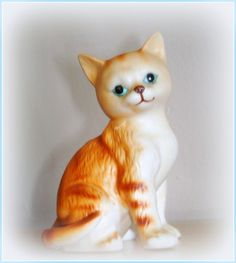 Our vintage orange Striped Tabby Cat figurine is in excellent to pristine condition...definitely a charmer for any cat person! Made of either glazed bisque porcelain or china, she stands almost 4 high x 3 across at the widest point. The colors are vivid as you can see and...oh, those blue eyes! Reminds me of a series of tabby cat figurines Lefton originated. Part of a collection put together in the late 80s to early 90s, you can tell this piece was well kept by its previous owner. She is a…