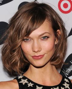 Karlie Kloss - mid/short bob with side swept fringe and partial wave. Love the warm medium brown colour!